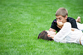 Young couple lying in a meadow, Vienna, Austria