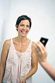 Woman laughing in a mobile phone