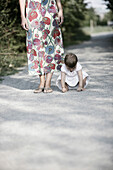 Baby girl playing on graveled path, Old Danube, Vienna, Austria