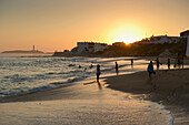 People on the beach at sunset, Cabo de Trafalgar in the background, Los Canos de Meca, Andalusia, Spain, Europe