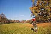 Portrait of a brunette woman in park in Autumn