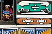 Africa, South Africa, Mpumalanga Province, KwaNdebele, Ndebele tribe, Mabhoko village, the artist Francina Ndimande at the window of her house
