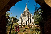 Myanmar (Burma), Mandalay State, Paleik village, Paleik pagoda complex, the bonzes A Shin Pannya Waw Tha and A Shin Dut Bawka going around the stupas dating from 16th and 17th century