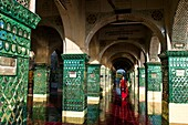 Myanmar (Burma), Mandalay State, Mandalay, Mandalay Hill, Su Taung Pyi Temple, the bonze Viciya going around the columns covered with glass mosaics