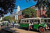 Myanmar (Burma), Yangon State, Yangon, Strand avenue, Custom House, a chevelet, a wooden bus of the second world war in front of the colonial building testifying the British Empire influence between 1886 and 1947