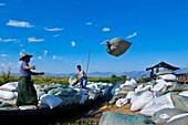 Myanmar (Burma), Shan State, Inle Lake, Mine Thauk village wharf, canoes unload supplies for the village