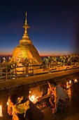 Myanmar (Burma), Môn State, Kyaiktiyo, Golden Rock, with the paya Shwedagon of Yangon and the paya Mahamuni of Mandalay, this Buddhsit site is one of the most revered in Myanmar, when night comes pilgrims keep on chanting psalms, light candles and meditat