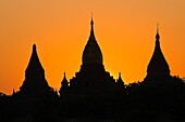 Myanmar (Burma), Mandalay State, Bagan (Pagan), Old Bagan, sun sets down over the old capital of the Pagan Kingdom founded in 849 that shelters an extraordinary archeological site of hundred pagodas and brick stupas built between the 10th and 13th century