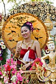 Thailand,Chiang Mai,Girl on Floral Float at Chiang Mai Flower Festival Parade