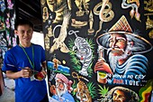 Thailand,Chiang Mai,Borsang Umbrella Village,Umbrella Artist with Artwork Sample Display