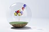 Balloons inside a glass bubble