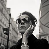 Woman Wearing Dark Sunglasses, Portait, Low Angle View, Paris, France