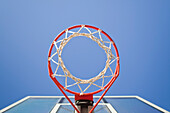 Basketball hoop, metal ring and netting, viewed from below. Green backboard. Sports court in Thousand Oaks, California, USA., Basketball hoop and net.