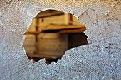 Ballard, Seattle, Washington, USA. A broken warehouse window. Looking into a derelict building., Broken glass pane