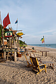 A resort and holiday destination in the Andaman sea. The beach and the shoreline. Waves. The Lanta Miami Hotel beach cabins., Ko Lanta Island, Krabi Province, Thailand.