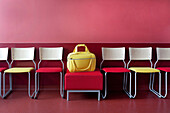 The maternity unit at a women's hospital. Public area, corridor and waiting room. Rows of chairs. A large yellow bag., Tartu University Women`s Hospital, Estonia