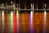 Neon lights reflect off Sacramento River at night, Sacramento, California, USA., Neon lights reflect off Sacramento River at night