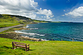 View over the coastline of the island of Skye, on the west coast of Scotland. A bench and viewing point on the cliffs., North Coast of Isle of Skye in Scotland