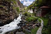 Kandru Village, a mountain village. Valley. A river with white water flowing over the rocks. Houses and path., Sichuan Tibet
