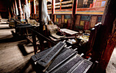 Derge Parkhang Printing House built in 1729. Equipment and printed matter. Religious texts. Hot metal set pages. Library. Wooden printing blocks. Historic press., Sichuan Tibet