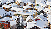 Snowy rooftops in the town of Andermatt, after a heavy winter snowfall. Ski resort and travel destination inthe San Gottard valley of the Oberalp in Switzerland., Andermatt, Switzerland