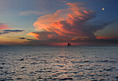 View of sloop on the horizon at sunset, Boracay, Philippines, Asia
