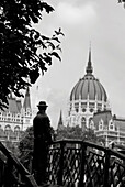 Human Statue on Bridge Overlooking Domed Parliament Building, Budapest, Hungary