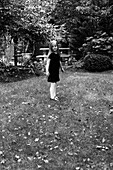Young Girl in Dress Standing in Yard, Portrait