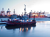 Tugboat at harbour with container terminal at dusk, Hanseatic City of Hamburg, Germany, Europe