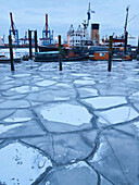 Frozen Elbe river at the harbour museum Oevelgoenne in the evening, Hanseatic City of Hamburg, Germany, Europe