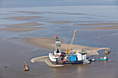 Aerial view of the construction of a wind turbine in the North Sea, Lower Saxony, Germany