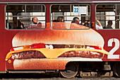 Tramcar, advertising a cheeseburger, Prag, Czech Republic