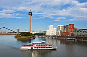 Excursion boat at media harbour, view to Rhine tower and Neuer Zollhof, Duesseldorf, North Rhine-Westphalia, Germany, Europe