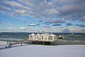 Pier under clouded sky in winter, Seaside resort Sellin, Island of Ruegen, Mecklenburg Western Pomerania, Germany, Europe