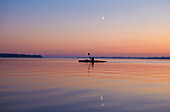 Kayak and moon at Salzhaff in the afterglow, Mecklenburg Western Pomerania, Germany, Europe