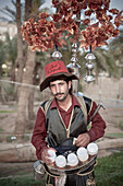 Traditional dressed tea vendor, Gulf of Aqaba, Red Sea, Jordan, Middle East, Asia