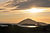View of backlit lake Myvatn (eastside), North Iceland, Europe