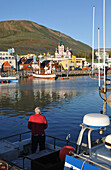 View of houses and boats at harbour of Husavik, North Iceland, Europe