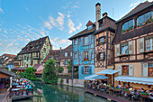 Restaurant and half timbered houses at the Lauch river, Little Venice, Colmar, Alsace, France, Europe