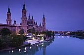 Spain, Aragon Region, Zaragoza Province, Zaragoza, Basilica de Nuestra Senora de Pilar on the Ebro River, dawn