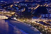 Spain, Basque Country Region, Guipuzcoa Province, San Sebastian, elevated view of town from Monte Igueldo, dusk
