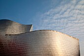 Spain, Basque Country Region, Vizcaya Province, Bilbao, The Guggenheim Museum, designed by Frank Gehry, dusk with Maman, spider sculpture by Louise Bourgeois