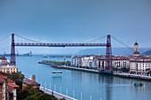 Spain, Basque Country Region, Vizcaya Province, Bilbao-area, Portugalete-Getxo, Puente Colgante, hanging bridge, designed by Alberto Palacio in 1893, dusk