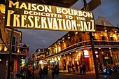 Louisiana, New Orleans, French Quarter, Bourbon Street, Louisiana, New Orleans, French Quarter, National Historic Landmark, street scene, Bourbon Street, Maison Bourbon, business, bar, nightlife, partying, live music, jazz, entertainment, sign, dusk, pede