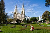 Sunday Afternnon Relaxation, Washington Square with view of Saints Peter and Paul Catholic Church, San Francisco, California, USA