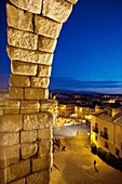 Night time view of Segovia through the arches of the Aqueduct of Segovia