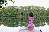 Girl on the pier in Lake Avral, Kirillovka, Samara Region, Russian Federation