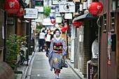 city , geisha , horizontal , Japan , kimono , Kyoto , lantern , many , one , paper , people , Pontocho , red , walking , World locations , S93-1573659 , AGEFOTOSTOCK