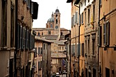 Looking down a street in World Heritage listed Urbino, Marche, Italy