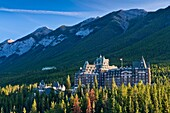 The imposing Banff Springs Hotel with Bow River, Banff National Park, Alberta, Canada
